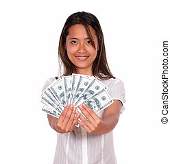 Pretty asiatic young woman with cash money