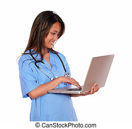 Charming asiatic nurse woman working on laptop - Portrait of...