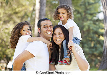 happy hispanic people parents giving children piggyback