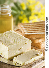 butter - fresh butter slice vith toast bread close up shoot