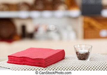 Tissue Papers And Glass On Coffee Shop Table - Closeup of...