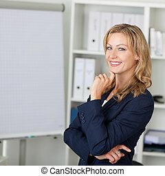 Mid Adult Businesswoman Smiling In Office