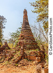 Indein, Inle Lake - Ancient Stupas at Indein overgrown with...