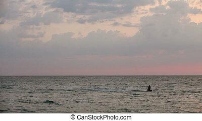 Kite surfer sailing  on the sea