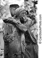 Gravestone - Statue of a sad woman on the grave on the...