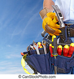Worker with a tool belt Construction and house renovation...