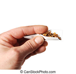Rolling cigarette - just started to hand roll a cigarette