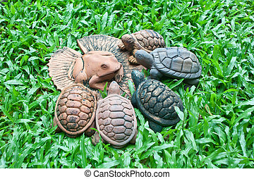 A pottery of frog on lotus leaf and turtles