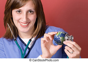 Earth Checkup - A young nurse holds a stethoscope to the...