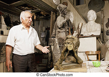 Sculptor showing his works - Senior sculptor showing his...
