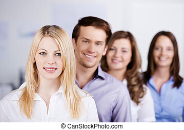Young Businesspeople Standing In A Row At Office - Portrait...