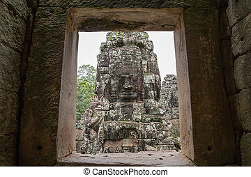 Bayon temple in cambodia, detailed view of face through...