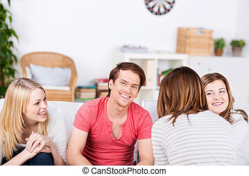 Friends Spending Time Together - Happy young male and female...