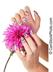 NAILS AND FLOWER - Two hands of the girl with beautiful...