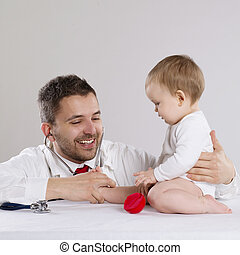 Doctor and child - Pediatrician doctor is playing with...