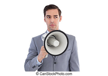 Business preparing himself to shout with a megaphone on...