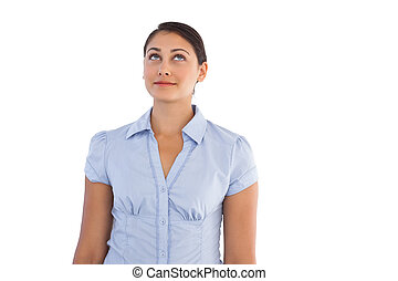 Thoughtful businesswoman standing alone on white background