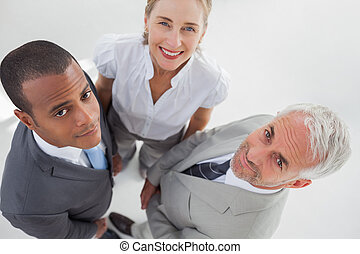 Overview of three business people standing close to each other