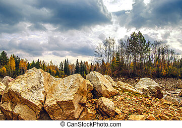 harsh landscape with rocks in the foreground