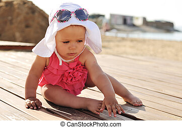 tanned baby girl on the beach