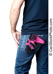 Macho man - A young man in jeans with a woman's panties in...