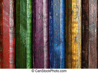 Colorful poles - Wall of rough wooden poles painted in...