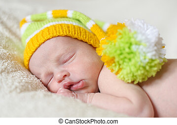 newborn  - sleeping newborn wearing funny hat
