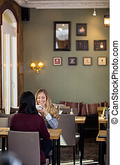 Happy Young Woman Having Coffee With Friend - Happy young...