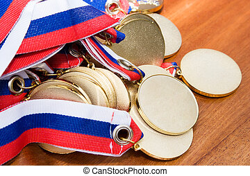 Gold medals before handing to champions