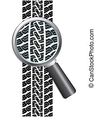 Close-up of tire with magnifier glass and white background
