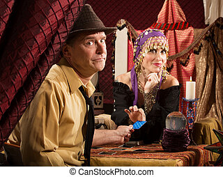 Fortune Teller Takes Credit Card - Beautiful fortune teller...