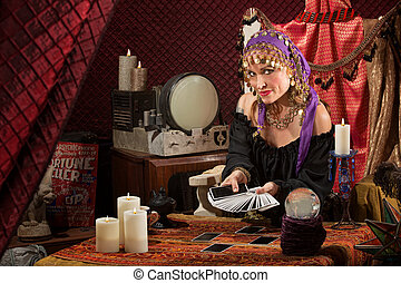 Sly Lady with Tarot Cards - Smiling gypsy soothsayer with...