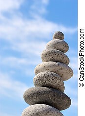 disbalance stones - Round stones on a background of blue sky
