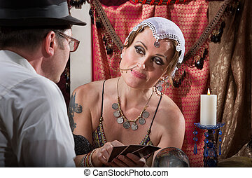 Cheerful Fortune Teller - Cheerful female fortune teller...
