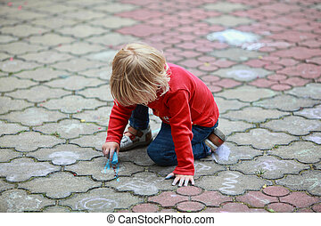 Child drawing with chalk - Preschooler child drawing with...