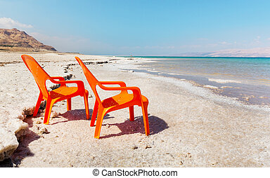 chairs on beach of dead sea