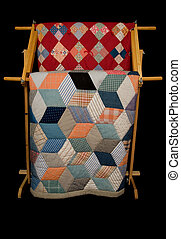 Two Quilts On A Rack