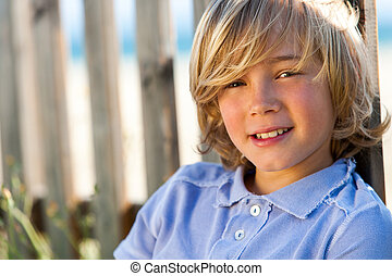 Face shot of handsome boy next to fence - Close up portrait...