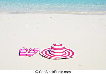 Flip-flops and hat on the beach