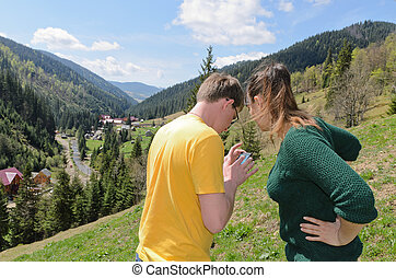 Couple checking mobile phone reception