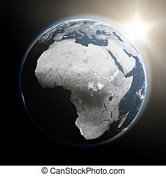 Sunrise over Africa - Space view of the sun rising over...