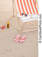 beach chairs with colorful towels and toys