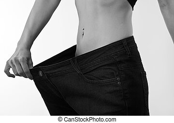 My jeans are to big - A picture of a young slim woman in...