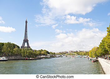 River Seine and the Eiffel Tower - The Seine River passing...