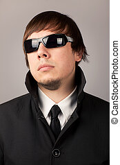Secret Service Agent - Close-up portrait of serious man in a...