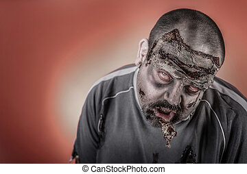 zombie with mechanical saw - is a man disguised as a zombie...