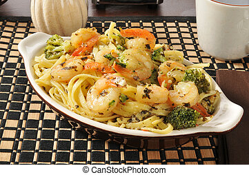 Shrimp scampi and linguini - A bowl of shrimp scampi and...