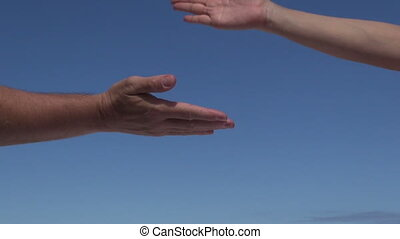 couple multiple greeting hands - woman and man hands...