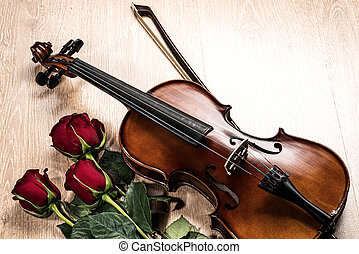 Violin, rose and music books, still life