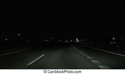driving night - subjective shot driving on a highway in...